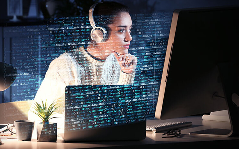 A lady in front of coding